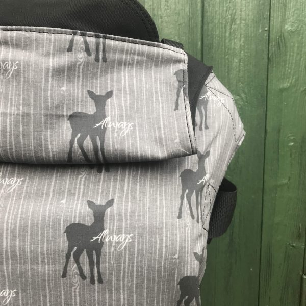 integra sling with a magic potter theme featuring the doe patronus known to lilly harry and snape. On grey wood effect background with black shoulder straps and waistband, with the word always written multiple times