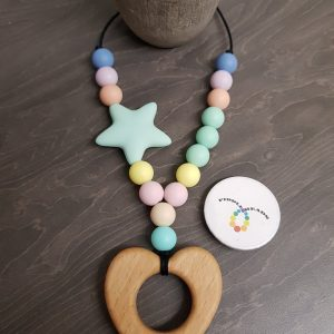 Hemp cord necklace with pastel beads, a featured pale green star and a wooden heart teether