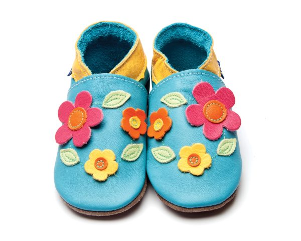 3d flowers on a a bright blue suede soled moccasin shoe
