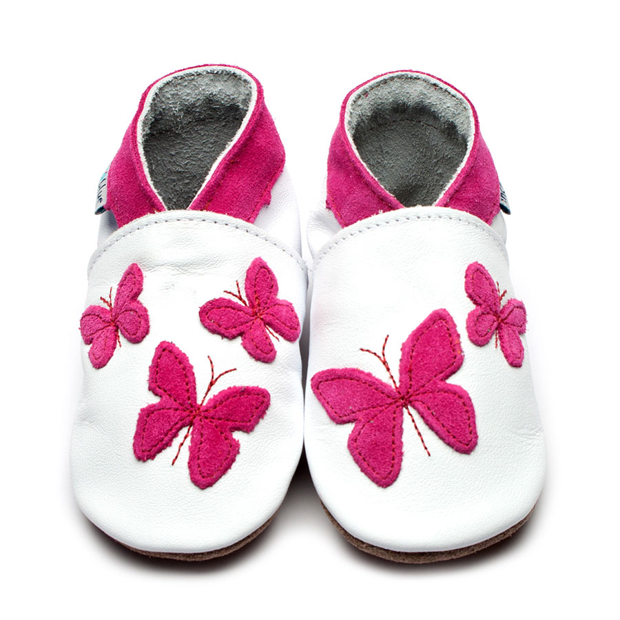 bright pink 3d butterfly applique n a white moccasin suede shoe