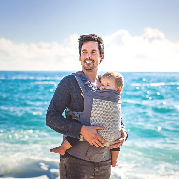 Beco COOL babywearing dad on holiday by the sea